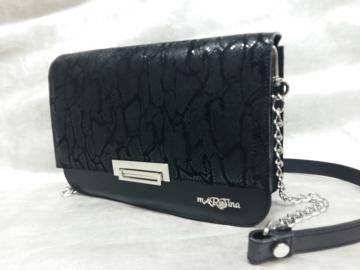 ženska torbica clutc